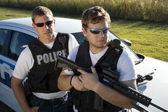 SWAT Officers Stand Beside a Police Car Stock Image
