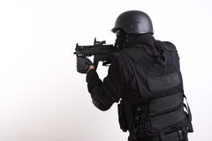 SWAT police officer. Aiming a rifle Royalty Free Stock Photos