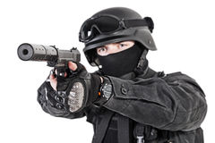 SWAT police officer with pistol. Spec ops police officer SWAT in black uniform with pistol studio Royalty Free Stock Photography