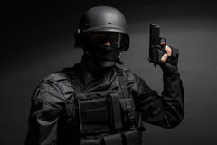 SWAT police officer with pistol Royalty Free Stock Image