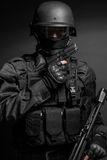 SWAT police officer with pistol Royalty Free Stock Photography