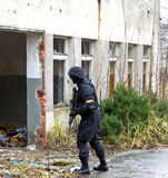 SWAT soldier. Asg game in old deserted factory Royalty Free Stock Photos