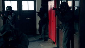 SWAT / Special Force Entering House. A Special Force Team entering a house stock footage