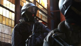 SWAT / Special Force. A Special Force Team looking arround and securing stock video footage