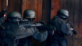 SWAT / Special Force. A Special Force Team storming through a door in a storehouse and securing stock video