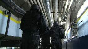 SWAT / Special Force. A Special Force Team storming throug a tunnel. Slow motion stock video