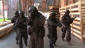 SWAT / Special Force. A Special Force Team storming trough storehouse. Slow motion stock video
