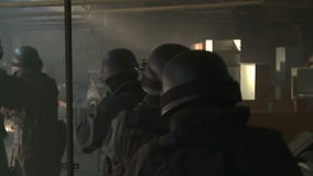 SWAT / Special Force. A Special Force Team walking, storming throug storehouse. Slow motion stock video
