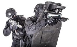 SWAT team behind ballistic shield studio shoot stock photos