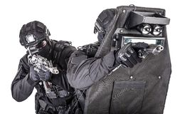 SWAT team behind ballistic shield studio shoot stock image