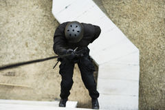 SWAT Team Officer Rappelling from Building Royalty Free Stock Photos