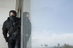SWAT Team Officer in Window Royalty Free Stock Photos