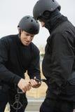 SWAT Team Preparing Climbing Equipment Royalty Free Stock Images