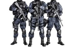 SWAT team. Special weapons and tactics SWAT team officers with guns Stock Photo
