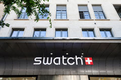 Swatch logo on the main store of the brand in Geneva. Swatch is one of the most famous watch manufacturers in Switzerland. NPicture of the logo of Swatch taken Stock Photography