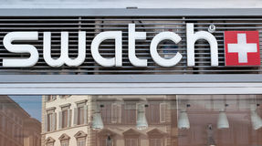 Swatch sign. Swatch (sign and Florence reflexion in the window )  is subsidiary Montres Flik Flak SA design, manufacture, distribute and service wristwatches Royalty Free Stock Photography