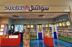 SWATCH in Villaggio Mall in Doha. Villaggio Mall in Doha, the capital city of Qatar, is a world class shopping destination surrounded by charming Venetian-styled Stock Image