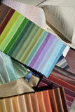 Swatches of fabrics for decoration. Different colors and textures Stock Photos