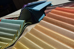 Swatches of fabrics for house decoration. Different colors and textures Stock Images