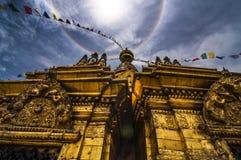 Swayambhunath under the Halo around the sun , Kathmandu , Nepal ,. Swayambhunath is an ancient religious architecture atop a hill in the Kathmandu Valley, west stock images