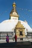 Swayambhunath stupa with monks Royalty Free Stock Photography
