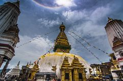 Swayambhunath under the Halo around the sun , Kathmandu , Nepal. Swayambhunath is an ancient religious architecture atop a hill in the Kathmandu Valley, west of stock photo
