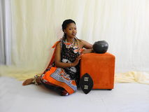 Swazi Woman. Half cut posing sitting Stock Image