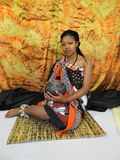 Swazi Woman. Half cut posing sitting Stock Images