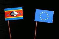 Swaziland flag with European Union EU flag  on black Royalty Free Stock Images