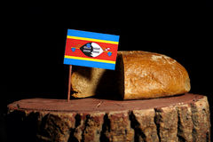 Swaziland flag on a stump with bread Royalty Free Stock Image