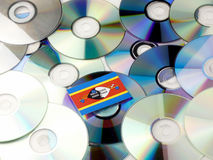 Swaziland flag on top of CD and DVD pile isolated on white. Swaziland flag on top of CD and DVD pile isolated Royalty Free Stock Image