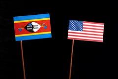 Swaziland flag with USA flag  on black Royalty Free Stock Photo