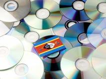 Swaziland flaga na górze cd i DVD stosu odizolowywającego na bielu Obraz Royalty Free