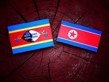 Swaziland flaga z koreańczyk z korei północnej flaga na drzewnym fiszorku Zdjęcia Royalty Free