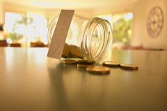 Swear jar filled with coins stock photography