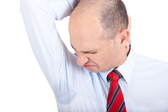 Sweat. A business man looking at his wet armpit Stock Photos