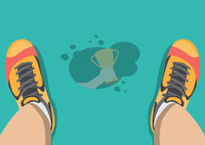 Sweat on floor grab trophy Stock Photos