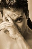 Sweat on his brow Stock Image