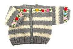 Sweater. Handmade toddler sweater on white background Stock Image