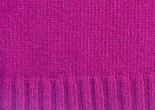 Sweater background. Texture of knitted soft mauve sweater background Royalty Free Stock Photo