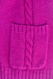 Sweater background. Texture of knitted soft mauve sweater background with pocket Stock Image