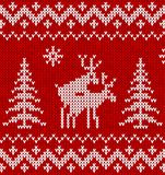 Sweater with deer. Red sweater with deer seamless pattern Stock Photo