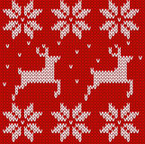 Sweater with deers. Knitted seamless background Stock Photography