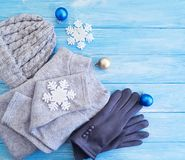 Sweater, gloves, hat cold toy, decor, Christmas, new year a background soft fashion. Sweater, gloves, hat fashion on a wooden background winter Christmas toy royalty free stock image