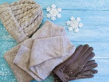 Sweater, gloves, hat weather a wooden background soft fashion. Sweater, gloves, hat fashion on a wooden background winter weather royalty free stock photography