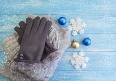 Sweater, gloves, hat weather cold Christmas toy, decor, Christmas, new year a background soft fashion. Sweater, gloves, hat fashion on a wooden background winter royalty free stock photo