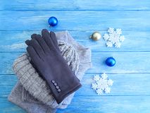 Sweater, gloves, hat weather cold toy, decor, Christmas, new year a background soft fashion. Sweater, gloves, hat fashion on a wooden background winter cold royalty free stock photo
