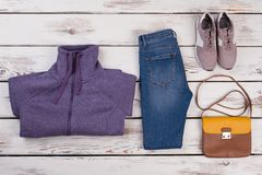 Sweater, jeans, sneakers and purse royalty free stock photo