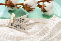 Sweater made of natural fabrics and branch with cotton blossoms royalty free stock photos