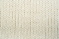 Sweater or scarf fabric texture large knitting. Knitted jersey background with a relief pattern. Wool hand- machine Stock Photography